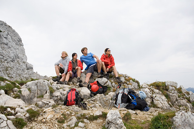 Hikers sat in top of mountain